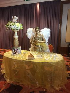 Angelic guest book table decoration.
