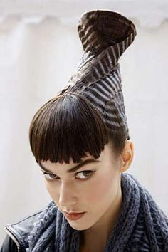 Interesting up-twist with great texture! Avant garde #hair. ##beauty #fashion #kuyam