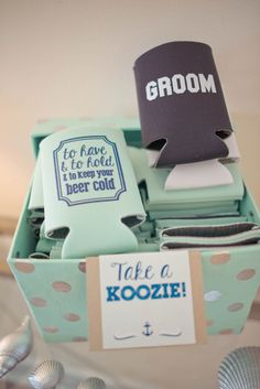 "The wedding favors included drink koozies, which read ""To Have & To Hold & To Keep Your Beer Cold."" The bride and groom also had their own custom koozies. 