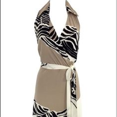 Abstract dress Faux wrap fully lined with a sexy neck line.Tan white and black sleeveless. With matching fabric belt Dress Barn Dresses