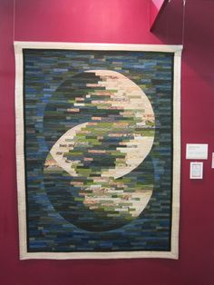 Moon reflected in water.  Strip quilt made by Chizuko Takiyama. 2016 Tokyo International Great Quilt Festival.  Photo by Queenie Patch.