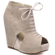 You'll envelope the epitome of fashion in this trendy spectator style from Two Lips.  Epitome has a beige mesh upper with lacing details at the vamp.  Cut outs through out add an edge to this 1 inch platform and 5 inch hidden heel.  Wear these wedges with any outfit and feel your inner fashionista shine through.