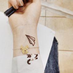 My new wrist tattoo! Love my paper plane...