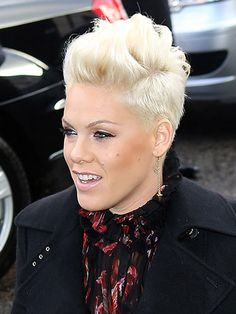 This songstress can rock an ultra-daring hairstyle with the best of them. #undercut #halfshavedhead #Pink