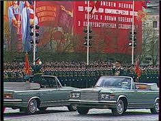 The parade commander General of the Army Petr Lushev (left, on ZiL limousine) reporting to Soviet Defense Minister Marshal Sergey Sokolov (right, on ZiL limousine) before inspecting the troops in the 1985 Moscow Victory Day Parade.