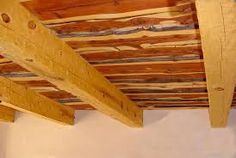 Rough hewn ceiling installation with beams