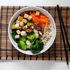 Heather's Hallelujah Bowl - a bed of brown rice layered with raw and lightly steamed veggies, tofu, nuts, and a dressing to die for.