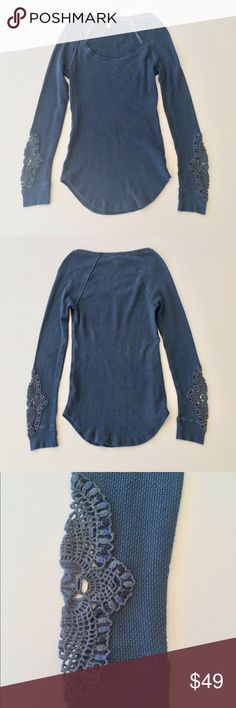 """We The Free Synergy Cuff Thermal Style: Thermal waffle knit fabric, scoop neck, crochet cuffs, rounded raw hemline. Measurements: ≈24-27"""" length; ≈26"""" sleeve length; ≈15"""" shoulder to shoulder. Color: Deep Sea Blue. Fabric: 57% Cotton, 38% Polyester, 5% Spandex body; 100% Cotton trim. Condition: Pre-owned with slight wear, a few loose threads, and missing hanger straps; otherwise great condition. Care: Machine wash cold. Free People Tops Tees - Long Sleeve"""