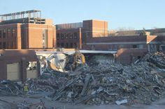 Seen from the second floor of Hach Hall, workers continue on the demolition of Davidson Hall on the Iowa State University campus. The staff and faculty of the 93-year-old building moved to the new Biorenewables Complex during the summer. Though the lot will someday be home to a new building, it will for the foreseeable future be a parking lot. Photo by Anthony Capps/Ames Tribune