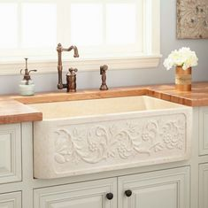 Dream Farm sink!! http://www.signaturehardware.com/kitchen/kitchen-sinks/farmhouse-sinks/33-polished-vine-design-marble-single-bowl-farmhouse-sink-polished-cream-egyptian-marble.html