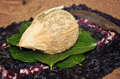 At a typical Sri Lankan Buddhist wedding, a coconut is cracked open as the couple steps down from the poruwa. Cinnamon Grand Nuga Gama weddings. - CarbonNeutral® Venue