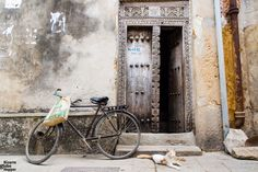 Don't visit Stone Town without getting to know famous Zanzibar doors! Learn how to identify Indian, Arab, and Swahili doors and read the carvings to reveal residents' social status, religion, and profession. Doors Of Stone, African Vacation, Mud House, Stone Town, White Sand Beach, Wooden Doors, Tanzania, Travel Pictures, National Parks