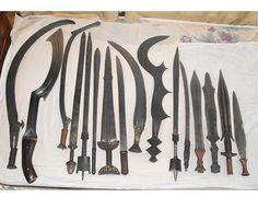 from left to right: Mongelima mambele, Egyptian Khopesh (not historically accurate, should've been made of bronze), Azande sabre, Tebu sword, Somali belawa, Maasai seme, Ngbandi sword, Manding broadsword, Ngbandi sabre, Ngombe execution sword, Somali belawa, Manding sabre, Songye sword, Salampasu sword, Fang fa, Boa sword.