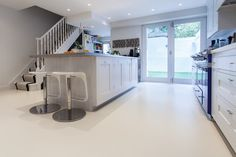 HomeSphere in Solid Bespoke Cream - the warmth of the floor keeps this minimalist kitchen still cosy