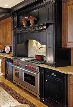 Love the different colored cabinetry around the stove and the mix of back splashes (stone & beadboard). Would love to do this in a distressed/antiqued white. Very nice kitchen idea.