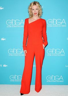 January Jones wearing a red Roland Mouret jumpsuit and black point-toe pumps at the 2015 Costume Designers Guild