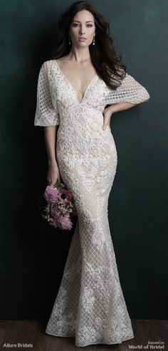 A beaded crosshatched pattern lends visual interest to this dolman sleeved gown.