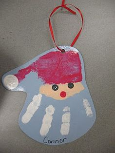 On the back: When you hang this ornament from year to year, I hope it brings a smile from ear to ear. This hand print Santa will help you remember, how small I was in the month of December of 2010.
