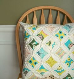 Think this pillow will go along with any bright colored room.