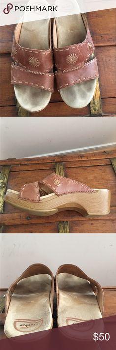 Dansko tan leather platform sandal Dankso tan leather platform sandal. Some darkening on footbeds. Dansko Shoes Sandals