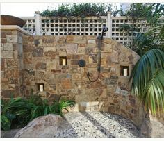 Outdoor pool shower - love the natural stone!!