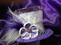 Purple Sparkly Mini top hat makes me wish I was the mad hatter!
