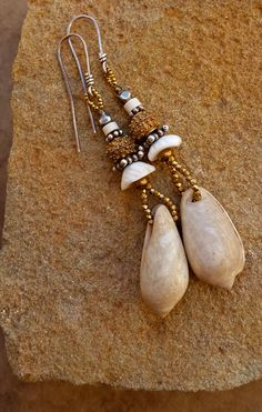 Pre Columbian Shell Earrings + Ancient Shell Beads + Mauritanian Shell + Antique Burmese Silver + Yoruba Brass + Antique Steel Cut Beads by DesertTalismans on Etsy