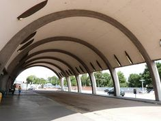The interior of the reinforced concrete arched bus station with copper-covered barrel vault roof. It was designed by Oliver Hill in 1937, but building had to be postponed due to  WW2 and the bus station didn't open until 1949. The original plan was to rebuild the Underground station but this never happened. Newbury Park, London.
