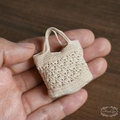 One miniature crochet bag made by with fine silk thread. It measures x 3 cm without the bag handle x 1 in) Crochet Pouch, Crochet Keychain, Knit Crochet, Silk Thread, Amigurumi Doll, Crochet Dolls, Hand Stitching, Bag Making, Fashion Dolls