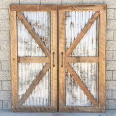 Reclaimed Wood Sliding Barn Door With Recycled Tin. This would be awesome over the laundry area.
