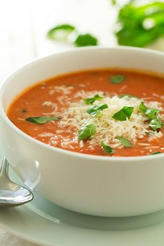 Creamy Tomato Basil Soup with Roasted Garlic and Asiago Cheese - this soup is to die for delicious!!