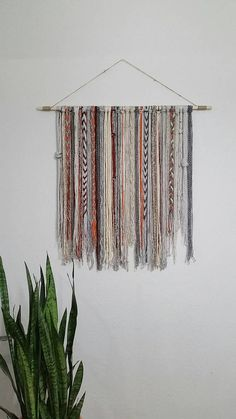 Bohemian YarnTapestry - Beige, grey, orange, and red This tapestry makes a great wall decor! This size of the wood is 36. The tapestry is about 32 across and about 32 down.