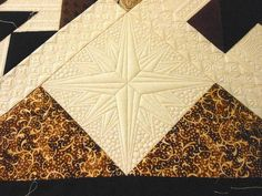 "Give your next quilt some rustic old-world charm with this beautiful True North Compass Block tutorial. With this easy <a href=""http://www.favequilts.com/Block-Patterns"" target=""_blank"" title=""Quilt Block Patterns"">quilt block tutorial</a>, you can create a stunning star compass using unique quilting techniques in no time at all. This step-by-step tutorial breaks down each step..."