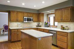 oak cabinets with shades of white/gray tile backsplash