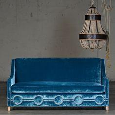 Beautiful velvet sofa.  Love the circle detailing.