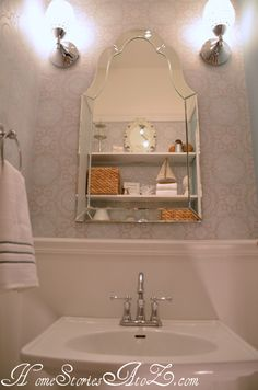 Love the mirror (and other pretty details in this little bathroom!)