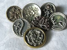 Lot of 7 ANTIQUE Flower Theme Metal  BUTTONS by abandc on Etsy