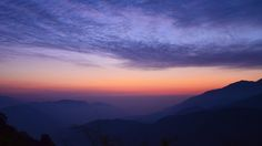 [OC] Sun setting with purple clouds over purple mountains at Chinjing Taiwan [4870  2739]