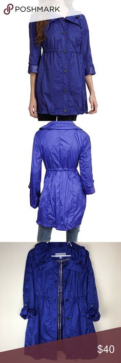 Andrew Marc New York Anorak Rain Jacket Perfect for Spring! Excellent condition!  Indigo Funnelneck with toggle drawstring pulls Button front closure Long sleeves can be rolled up with snap-tab Concealed zip breast pocket Tailored seam details Elastic waist toggle Drawstring pulls at hem Andrew Marc Jackets & Coats