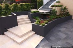 notice the slate(?) tiles, retention wall, and built in concrete planters