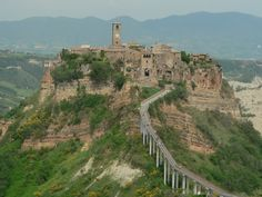 Civita Italy, the most amazing place you will ever visit. I know it looks like a bridge but it's actually a foot path. No cars, no hurry or worry,  You go back in time like you stepped through a portal, wish we could have spent more time here.