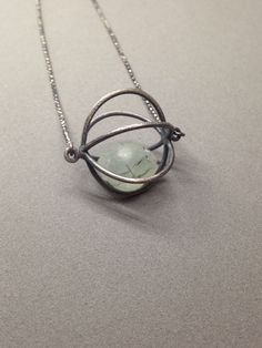 cage pod necklace oxidized sterling silver modern art jewelry kinetic jewelry prehinite crystal ball rutile by jaimejofisher on Etsy https://www.etsy.com/listing/230828936/cage-pod-necklace-oxidized-sterling