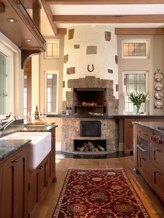i love kitchen fireplaces - isn't everyone ALWAYS in the kitchen anyway for parties!!