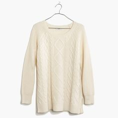 An intricate cableknit front. Sweatshirt-style raglan sleeves. A laid-back take on a traditional look that, oh yeah, kind of goes with everything.  <ul><li>True to size.</li><li>Merino wool.</li><li>Dry clean.</li><li>Import.</li></ul>
