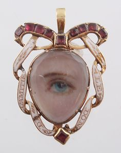 Eye Miniature pendant Georgian  C. 1790 -   Blue eye hand-painted on ivory under rock crystal with foiled garnets and white enamel marked IL DON DE L'AMITE (gives friendship) -   Pendant is hinged at the top and there is an compartment on the back.