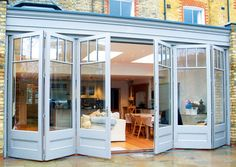 Browse our gallery of bifold doors, french doors and patio doors. Kitchen Patio Doors, Kitchen Bifold Doors, Bi Folding Doors Kitchen, Kitchen Wood, Kitchen Design, Extension Veranda, Rear Extension, Orangery Extension, Extension Ideas