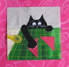 Kitty, swiping fabric off the cutting mat; an original block designed and made by FlossieBlossoms