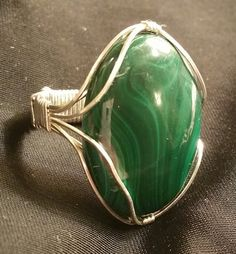 Check out this item in my Etsy shop https://www.etsy.com/listing/221276974/huge-malachite-cabochon-ring-size-9