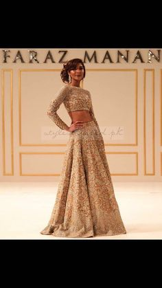 Faraz Manan is a famous Pakistani fashion designer whose designs speak for itself. This elegantly exquisite lehnga choli in nude/gold tones is