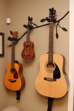 Branch shaped guitar holder set of 3 . 1 ,Holds 3 instruments and 2 single instrument branch shaped racks